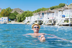 Portrait of young man swimming in the sea Royalty Free Stock Images