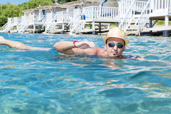 Portrait of young man swimming in the sea royalty free stock photos