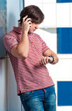 Portrait of a young man talking on phone Stock Image