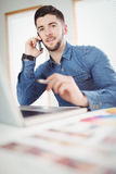 Portrait of young man talking on phone Royalty Free Stock Image