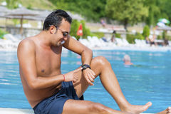 Portrait of young man talking on the phone on the pool Stock Photography