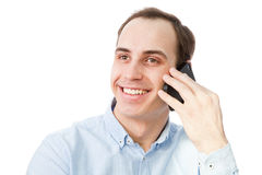 Portrait of young man talking on the phone. stock images