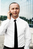 Portrait of young man talking phone Royalty Free Stock Photo