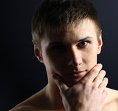 Portrait of young man thinking Stock Photo