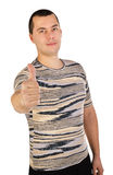 Portrait of young man with thumb up Royalty Free Stock Images