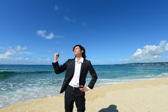 Portrait of young man on a tropical beach Royalty Free Stock Photo