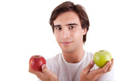 Portrait of a young man with two apples in their h Stock Image