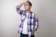 Portrait of a young man upset look holding his head stock photography