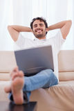 Portrait of a young man using a laptop Royalty Free Stock Photos