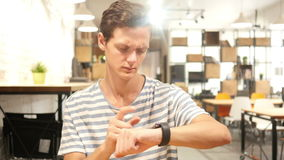 Portrait of Young Man Using smartwatch, stock video footage