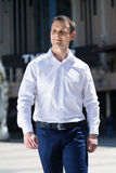 Portrait of a young man walking downtown street Royalty Free Stock Photo