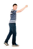 Portrait of a young man walking with his hand raised Royalty Free Stock Images