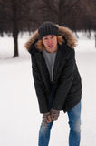 Portrait of young man walking in winter Park Royalty Free Stock Photography