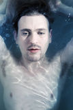 Portrait of a young man in the water stock image