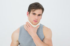 Portrait of a young man wearing cervical collar. Over white background royalty free stock photography
