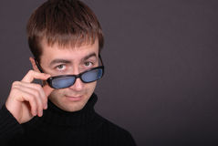 Portrait of young man wearing glasses royalty free stock image
