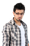 Portrait of a young man wearing glasses. On the white background royalty free stock photography