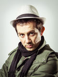 Portrait of young man wearing hat and scarf stock photography