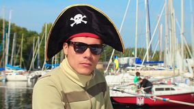 Portrait of young man wearing pirate hat, yachting, sailing. Stock footage stock video