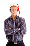 Portrait of young man wearing santa hat Royalty Free Stock Images