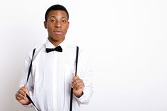 Portrait of young man wearing suspenders over white background Royalty Free Stock Photography