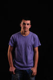 Portrait of young man wearing t-shirt looking at the camera Stock Photo