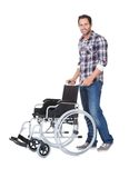 Portrait of young man with wheelchair Stock Photo