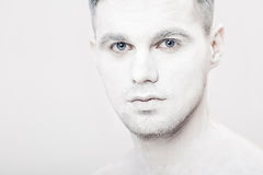 Portrait of young man with white face paint. Professional Fashion Makeup. fantasy art makeup Stock Photo
