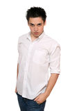 Portrait of young man in a white shirt Royalty Free Stock Photos