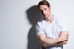 Portrait of young man in white t-shirt. Royalty Free Stock Photos