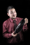 Portrait of a young man who advertises shiny shoes Stock Images