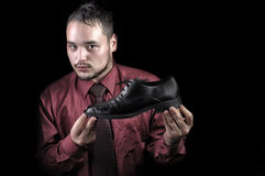 Portrait of a young man who advertises shiny shoes Stock Photo