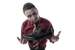 Portrait of a young man who advertises shiny shoes Royalty Free Stock Photo