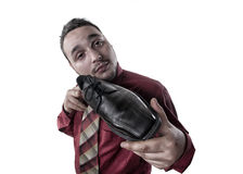 Portrait of a young man who advertises shiny shoes Stock Photography