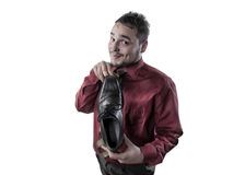 Portrait of a young man who advertises shoes Royalty Free Stock Image