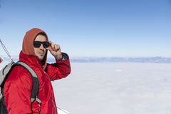 Portrait of young man in the winter mountain above the city fog Stock Image