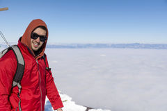 Portrait of young man in the winter mountain above the city fog Royalty Free Stock Photography