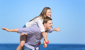 Portrait of young man and woman on a beach Stock Photography