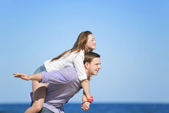 Portrait of young man and woman on a beach Stock Photos