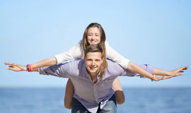 Portrait of young man and woman on a beach Stock Images