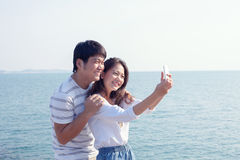 Portrait of young man and woman selfie ,self portrait by mobile Royalty Free Stock Photo