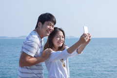 Portrait of young man and woman selfie ,self portrait by mobile Stock Photography