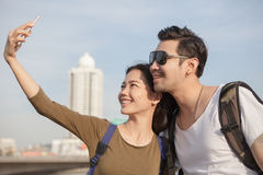 Portrait of young man and woman selfie ,self portrait by mobile Stock Images