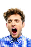 Portrait of a young man yawning Royalty Free Stock Images