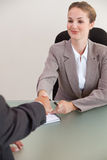 Portrait of a young manager shaking the hand of a customer Royalty Free Stock Photography