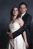 Portrait Of Young Married Couple. Over Black Background Stock Image