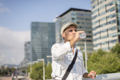 Portrait of a young and masculine man drinking a water outside. Young and masculine man drinking a water outside Stock Images