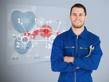 Portrait of a young mechanic next to futuristic interface Stock Photography