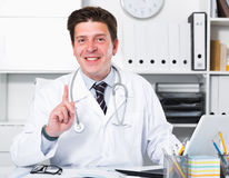 Portrait of young medical worker. In medical Center sitting at the table Stock Photo