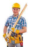 Portrait of a young men with carpentry tools and planks Stock Photography